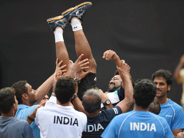 File photo: Leander Paes lifted by his teammates after India's victory in Davis Cup