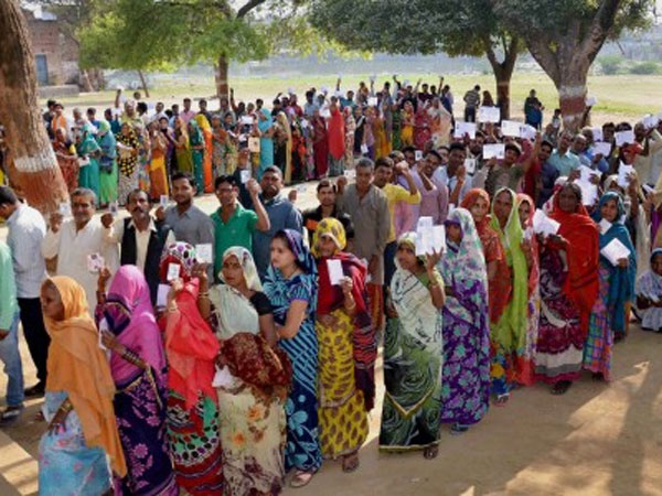 People line up at a polling station in Mirzapur during the seventh and final phase of voting in Uttar Pradesh.