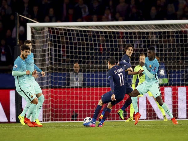 File photo: PSG's Angel Di Maria attempts a shot at goal against Barcelona