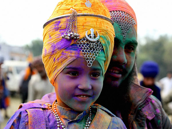 Sikhs participate in a parade at Anandpur Sahib on the occasion of Holla Mohalla.