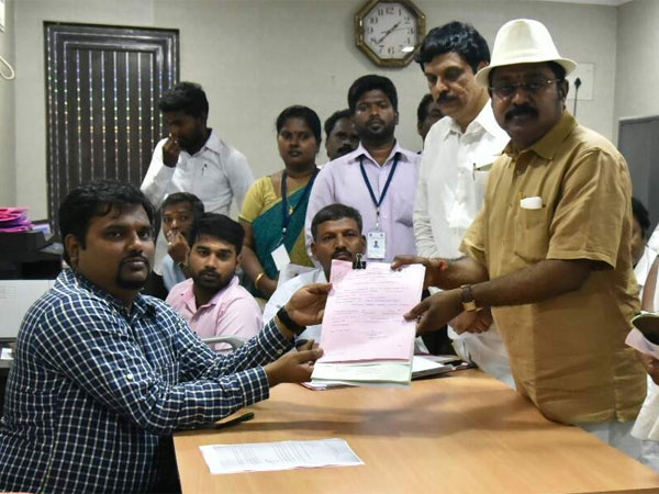 R K Nagar: TTV files nomination with a hat on his head