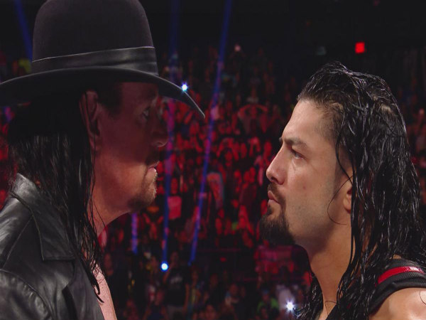 The Undertaker (left) and Roman Reigns (Image courtesy: wwe.com)