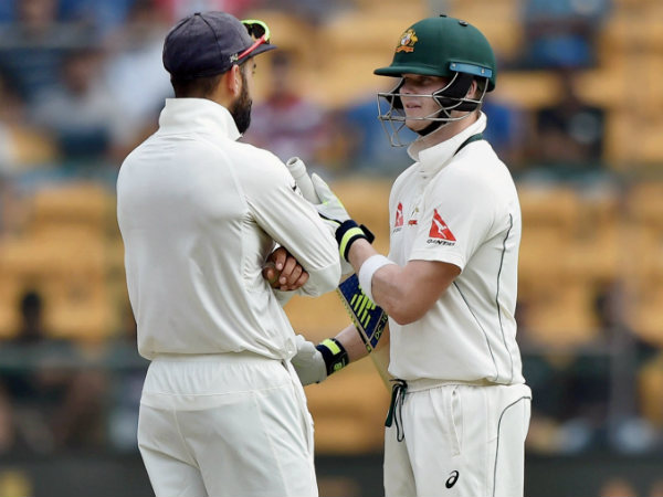 Virat Kohli (left) and Steve Smith have a chat during the 2nd Test in Bengaluru