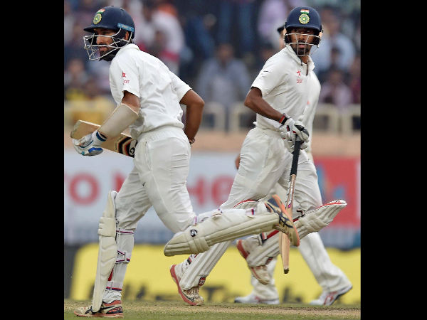 Cheteswar Pujara and Wriddhiman Saha cross each other to complete a run during 4th day of 3rd Test