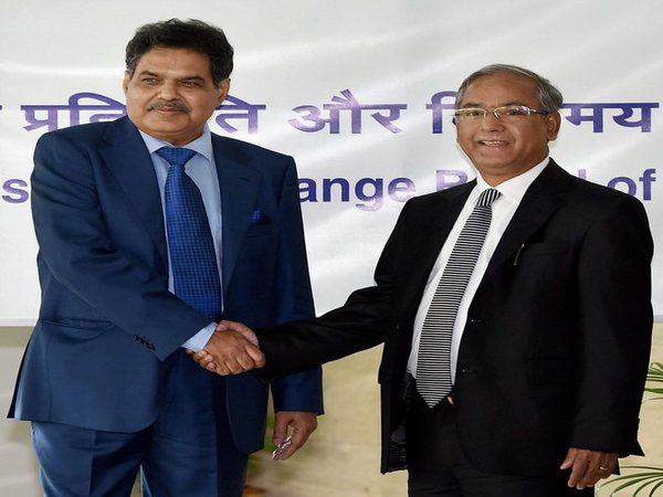 Newly appointed SEBI Chairman, Ajay Tyagi (left) is greeted by the outgoing chairman, U K Sinha, in Mumbai