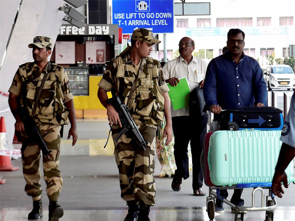 Security personnel stand guard at the Chennai International Airport on Sunday after airports in Mumbai, Hyderabad and Chennai were put on maximum alert following threats of a hijack attempt.