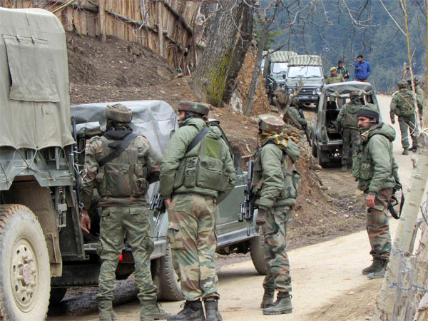 Army personnel take positions during an encounter with the militants at Kupwara district of north Kashmir. PTI file photo