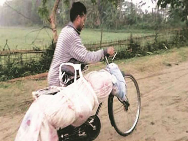No motorable roads in Assam CM's constituency Majuli; man carries dead brother on bicycle