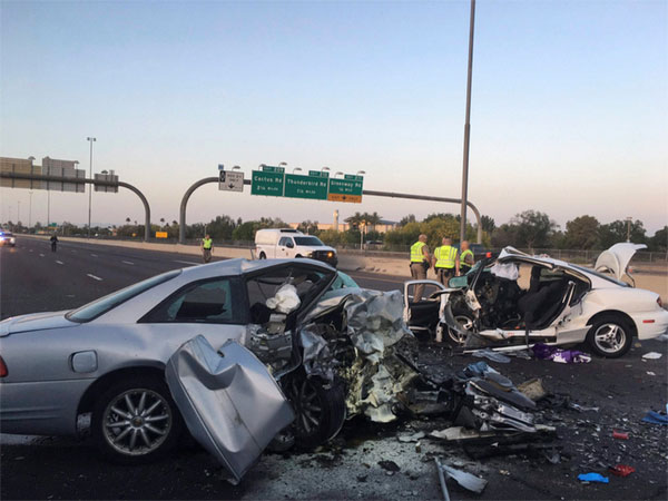 Mangled remains of cars involved in a fatal accident on the Northbound Interstate 17 in Phoenix.