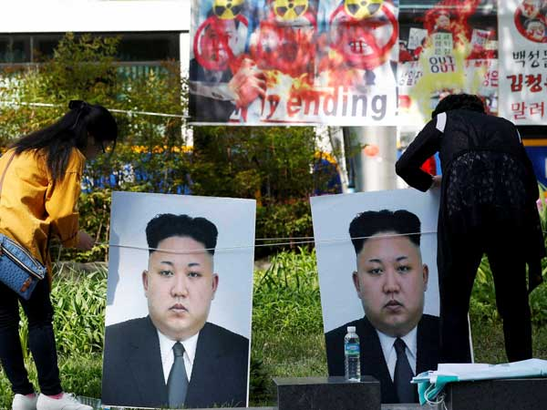 File photo of participants in Seoul setting the portraits of North Korean leader Kim Jong Un during a rally denouncing North Korea's nuclear test