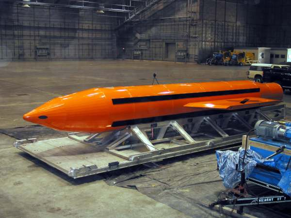 A Massive Ordnance Air Blast (MOAB) weapon is prepared for testingat an armament center. Photo credit: Wikimedia Commons/US Department of Defense.