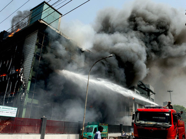 Firefighters douse a fire that broke out at Excel Greentech Private Limited in Noida.