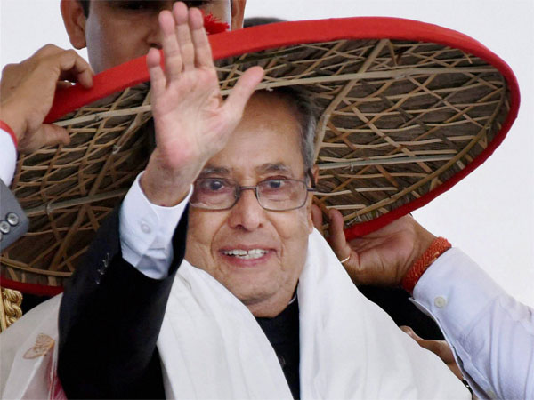 File photo of President Pranab Mukherjee waving at the crowd in Guwahati during inauguration of five-day 'Namami Brahmaputra' festival.