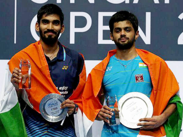 Sai Praneeth (right) and Srikanth pose with their trophies after the Singapore Open final