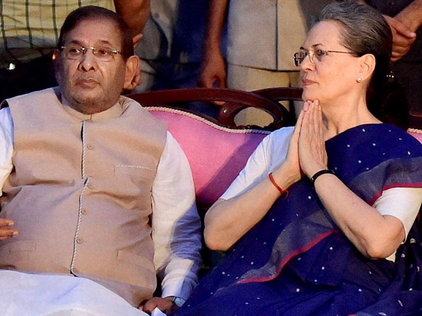 Congress President Sonia Gandhi and senior JD-U leader Sharad Yadav at a party