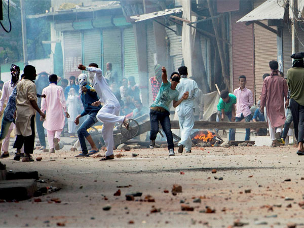 Youths pelting stones at security personnel during clashes that erupted on Monday