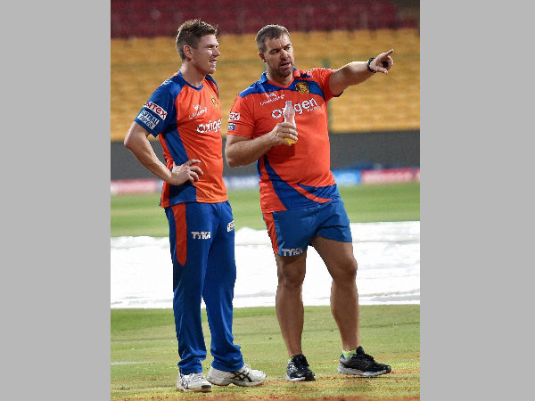 File photo: Gujarat Lions bowling Heath Streak (right) with James Faulkner