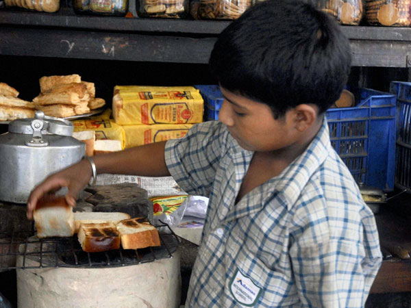 A child seen working at a tea stall. Photo credit: PTI