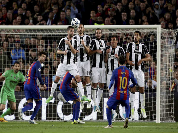 Barcelona's Lionel Messi (right) against Juventus