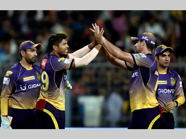 Umesh Yadav (2nd left) celebrates with his KKR team-mates after dismissing KXIP captain Glenn Maxwell