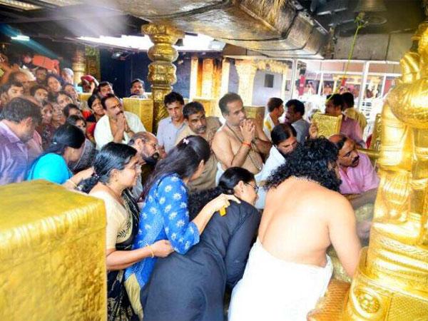 Kerala government orders probe after photos of young women at Sabarimala goes viral
