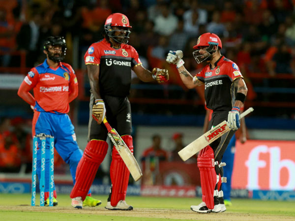 Gayle (centre) with Kohli (right) during IPL 2017