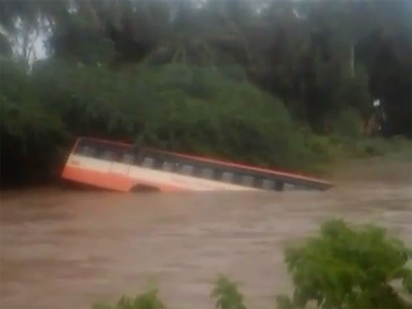 Bus swept away by gushing waters