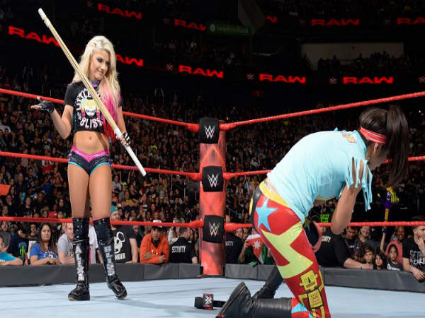 Alexa Bliss (left) attacking Bayley (Image courtesy: wwe.com)