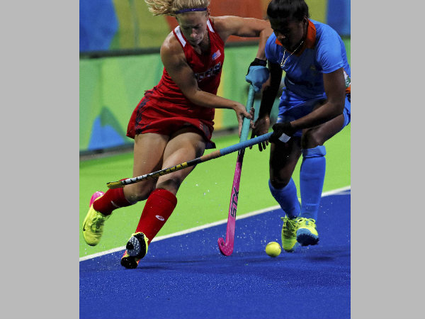 File photo: India's Sunita Lakra (right) fights for the ball with United States' Katie Bam