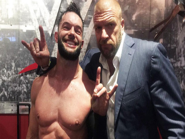 Finn Balor (left) and Triple H (Image courtesy: Youtube)