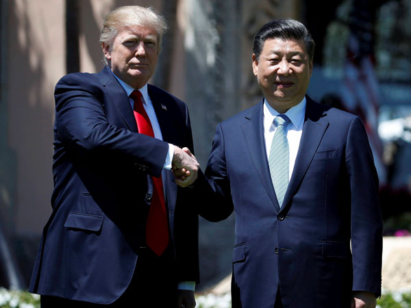 US President Donald Trump and Chinese President Xi Jinping. PTI file photo