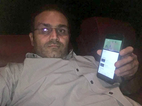 Virender Sehwag watching IPL match at a movie theatre (Image courtesy: Virender Sehwag Twitter handle)