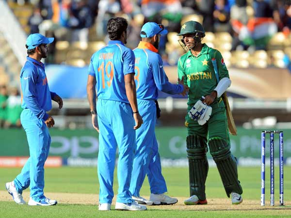 Indian players shake hands with Shadab Khan