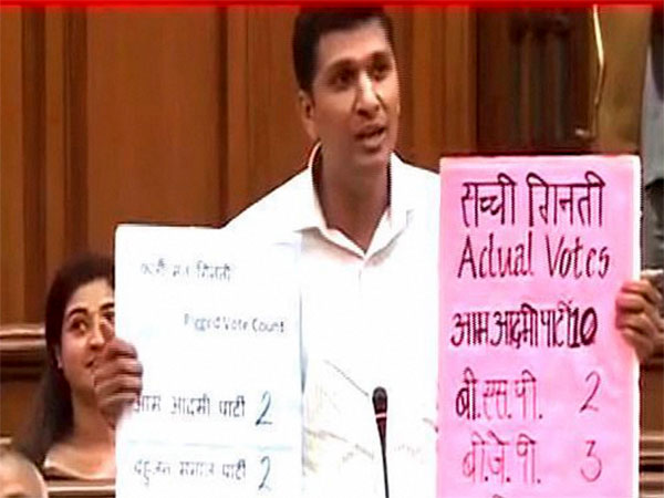 TV Grab-- AAP MLA from Greater Kailash Saurabh Bharadwaj demonstraties how an EVM can be manipulated at the special Delhi Assembly session convened by Chief Minister Arvind Kejriwal. PTI file photo