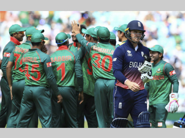 File photo: Bangladesh players celebrate the dismissal of England's Jason Roy (right) at Champions Trophy 2017
