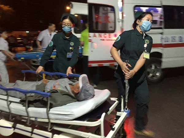 Medical workers transport a person injured in China kindergarten explosion on Thursday. Photo credit: PTI