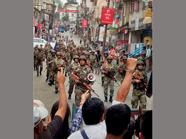 CRPF troops patrol the streets a day after Gorkha Janmukti Morcha supporters resorted to violence. The situation remained tense in the hills with thousands of tourists stranded. PTI Photo