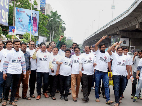 Textile traders protest against the GST during a day-long strike in Surat on Tuesday. PTI Photo