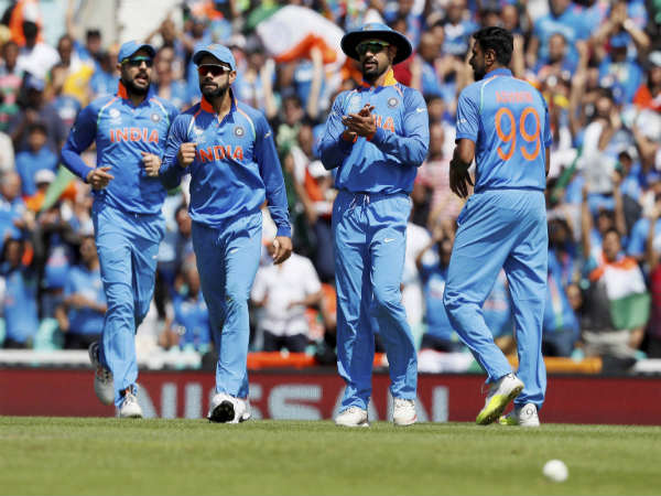 Indian players celebrate a South African wicket