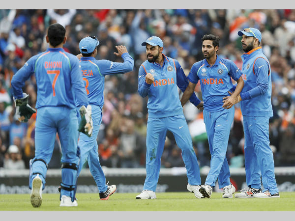 Indian players celebrate a Sri Lankan wicket at The Oval