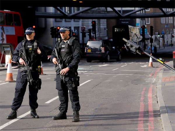 Two armed police guard an area near Borough Market in the London Bridge area of London