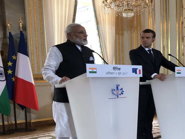 PM Modi with French President Emmanuel Macron at at Elysee Palace in Paris