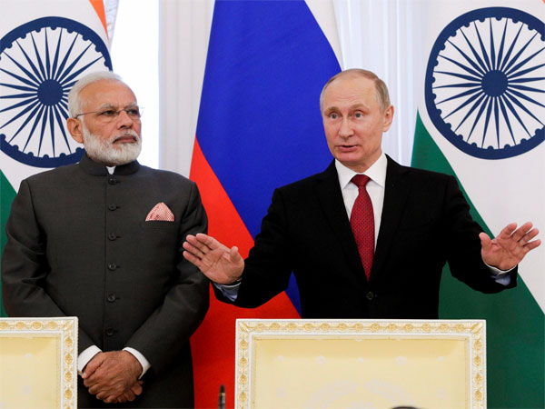 India's Prime Minister Narendra Modi, left, and Russian President Vladimir Putin speak to the media after a signing ceremony at the St. Petersburg International Economic Forum in St. Petersburg, Russia