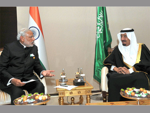 Prime Minister Narendra Modi talks with King Salman bin Abdul Aziz of Saudi Arabia