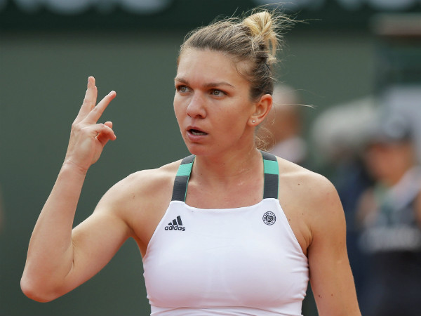 Simona Halep gestures during a match at French Open
