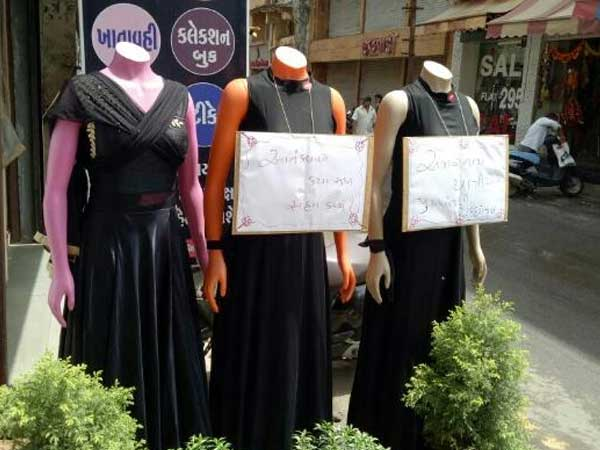 Placards on mannequins condemning attack