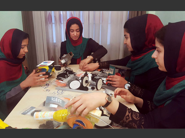Teenagers from the Afghanistan Robotic House practice at the Better Idea Organization center. Photo credit: PTI