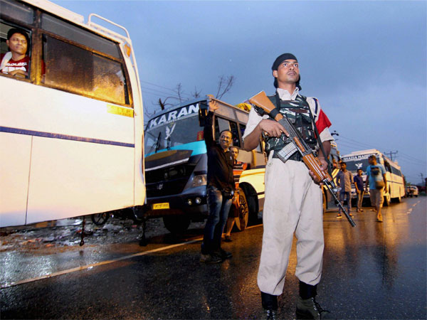 A paramilitary security personnel keeping vigil as a convoy of Amaranth pilgrims leave for Kashmir on the outskirts of Jammu