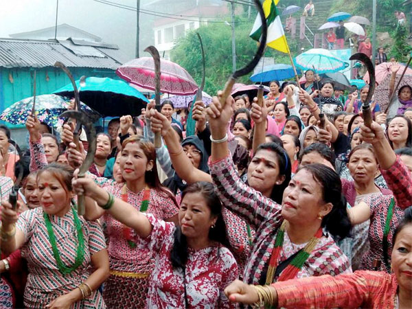 GJM woman suppoters take part in a mass rally in Mangpoo near Darjeeling on Thursday. PTI Photo