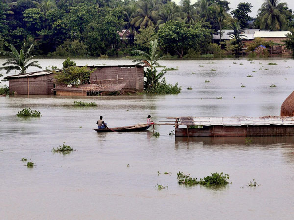 Villagers take services of a boat to reach to a safer place as incessant rains created a flood-like situation at Kureni Bori in Morigaon district of Assam